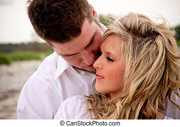 Couple on the Beach - A young attractive couple together on...