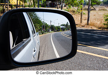car mirror - rear car mirror and rural road view
