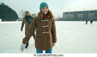 Active Youth - Couple having fun at skating rink