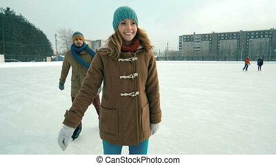 Active Youth - Couple having fun at skating rink