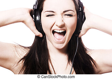 Girl singing with headphones - A pretty young woman...