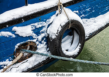 Fishing boat in a port in winter - Fender on a fishing boat...