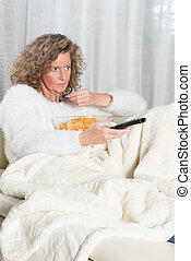 woman eating chips and zapping