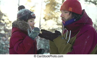 Winter Activities - Close up of father and son having fun...