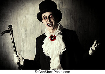 dracula - Handsome male vampire in a tail-coat and top-hat...