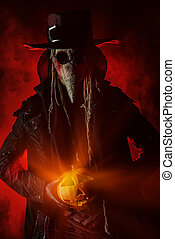 contagion - Frightening plague doctor stands with a pumpkin...
