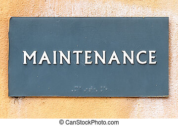 Maintenance Sign with the words Maintenance at a wall