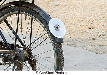 cd disc on rear mudguard of bicycle, used as reflector,...