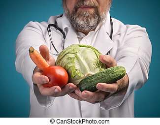 Healthy food concept. - Health food concept. Doctor holding...