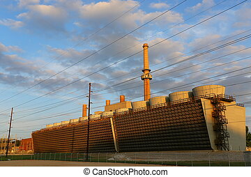 power plant cooling towers at sunset