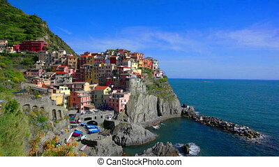Manarola village on cliff rocks and sea , Seascape in Five...