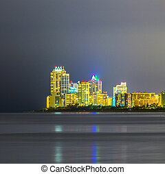 skyline of Miami sunny isles by night with reflections at...