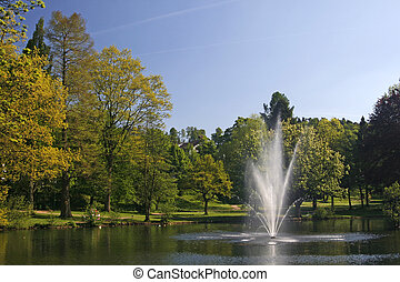 Pond with fountain in Georgsmarienhuette, Lower Saxony,...