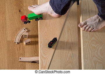 Tripped over child's toy - Close-up of man tripped over...