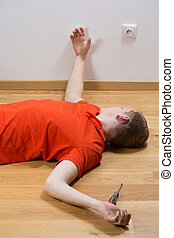 Electrocuted man lying on the floor - Image of electrocuted...