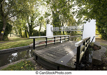swing bridge and foot bridge over an English canal