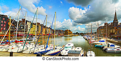 Honfleur skyline harbor, boats and water Normandy, France -...