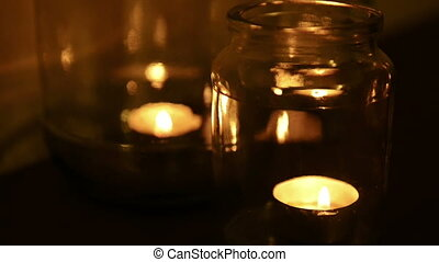 Candles Burning - Small tea light candles burning in glass...