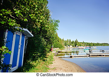 boat docks - A boat shed by a lake and docks