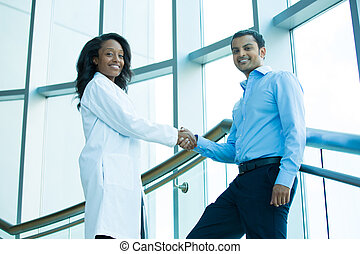 Handshake - Closeup portrait of health care professional or...