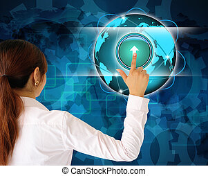 Business women pushing a button on a touch screen interface