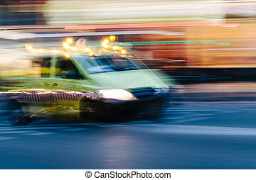 Ambulance Car in a Blurred City Scene