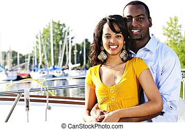 Happy couple at seaside - Young romantic couple hugging and...