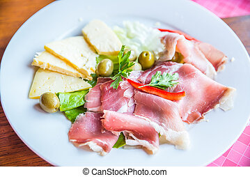 delicatessen plate with cheese ham and olives