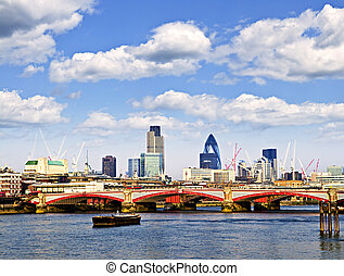 Blackfriars Bridge with London skyline behind from Thames...