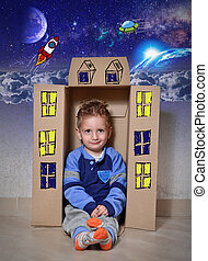 Spaceship flight - Child playing with a cardboard box...