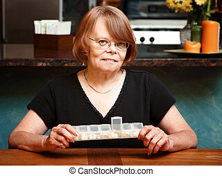 Senior woman with daily supplements
