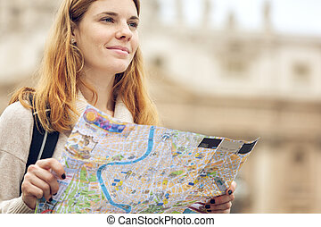 Young beautiful woman with map - Young beautiful woman...