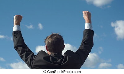 Businessman Raising Victory Arms