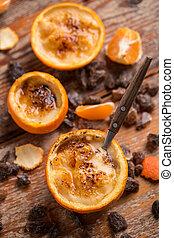 Catalan cream, spanish dessert in orange peel