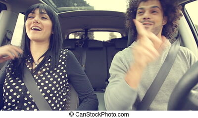 Cool couple dancing in car