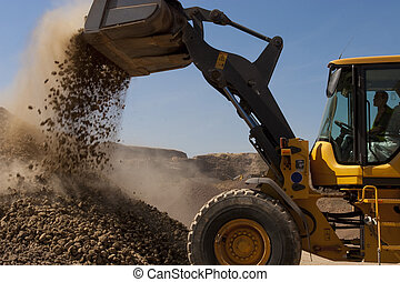 bulldozer in action in a big quarry