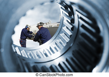mechanics and giant cogwheels - two engineers seen through a...