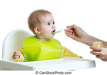 baby eating food isolated