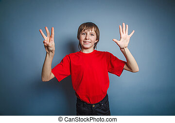 European-looking boy of ten years shows a figure eight finger on