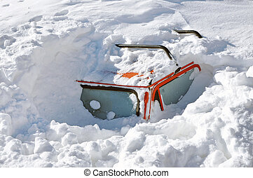 Snow covered car in the winter blizzard