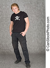 Young guy in a T-shirt with piracy symbolics - The young guy...