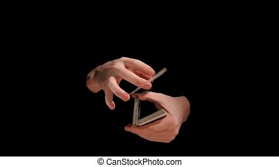 Magic trick with playing cards on black background, slow...