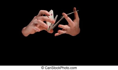 Magic hands doing a magic trick with cards on black...