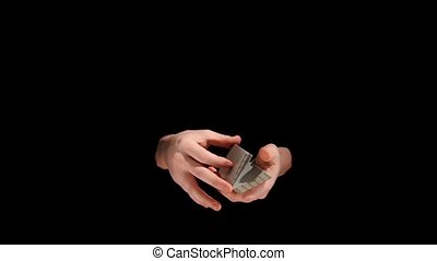 Magic trick with cards on black background, slow motion - An...