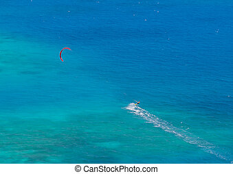 Kite surfer as seen from the air in the Caribbean