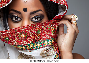 Exotic Indian bride dressed up for wedding ceremony