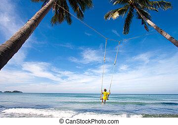 swing in sea - Boy swing in the sea