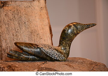 Carved northern loon on wood