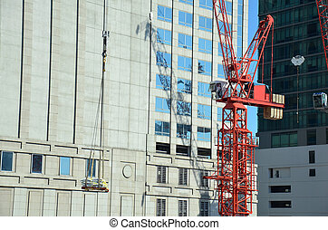 Machinery on Construction Site - People working on Building...