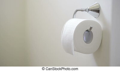 Toilet Paper Roll - Person unrolls toilet paper tissue in...